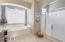 Double sinks, vanity, garden tub and walk in shower
