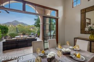 Dramatic mountain views are the backdrop in the great room, dining area and master bedroom.