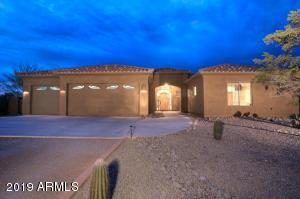 Custom North Scottsdale home on NEARLY an ACRE has 3 bd + Den, 3 bath 3128 sqft