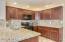 Upgraded raised panel cabinets and granite counters with granite backsplash!