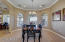 Separate Dining room with crown molding and views of the back patio