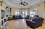 Great room with built in entertainment area, French doors to Deck
