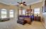 Huge Master suite with expansive ceilings with oversize crown molding and lovely sitting area, his and her walk in closets, separate hallway to the large master bath