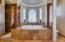 Master bathroom whirlpool tub complete with custom pillars