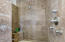 Travertine Snail shower in master bathroom complete with 3 shower heads including a rain shower above. corner bench seat