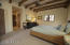 Spacious Bedroom With Wood Beam Ceiling
