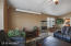 Family room/dining room with TV screen and projector