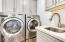 Laundry room with custom cabinets and built-in sink