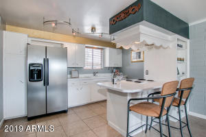 Light and bright kitchen space with Stainless Steel fridge, dishwasher, oven/stove and built in bookcase!