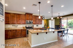 Cherry Cabinets, Granite Countertops, Stainless Steel Appliances, Pendant Lighting