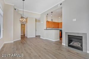 Beautiful living, dining and kitchen space with wood floors.
