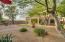 Lush and professionally landscaped backyard