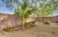 The backyard lot is spacious and professionally landscaped with low-maintenance plants and trees, as well as lots of shade and a water feature! Plenty of room for a pool!