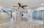LARGE LIVING/DINING ROOM WITH WOOD PLANK TILE FLOORING.