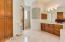 MASTER BATH HAS TWO WALK IN CLOSETS, WALK-IN SHOWER, SOAKING TUB, CUSTOM CABINETRY