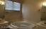 Huge tub in master bath for relaxing in your beautiful new home