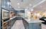 Quartz counters, designer pendant lights, gorgeous cabinetry.
