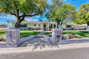 Welcome home to your Arcadia ranch estate on a 1/2 Acre lot in walkable Paradise Valley