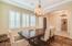 Formal dinning, beautiful wood flooring, step-up ceiling, shutter everywhere