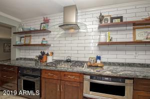 Kitchen with Subway tiles, Granite counters.
