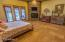 Master bedroom with walkout to the back patio/lake front.