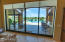 Motorized Shades on the pocket doors with an amazing view of the pool/lake.