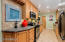 CHALKBOARD ACCENT PIECE FITS PERFECTLY IN THIS MODERN AND INVITING KITCHEN.