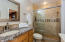 MASTER BATHROOM FEATURES TUMBLED STONE TILE, GRANIT COUNTERS, UPGRADED VANITIES AND UPDATED LIGHTING.