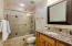 HALL BATHROM FEATURES WONDERFUL UPDATES AS WELL, INCLUDING GRANITE, TILE AND LIGHTING.