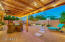 THE PERFECT COVERED PATIO AND YARD WITH BEAUTIFUL LIGHTING, STEPPING STONES, FIREPIT, AND ALL EASY-CARE LANDSCAPING.