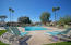POOL FEATURES LOTS OF LOUNGE CHAIRS AND A RAMADA.