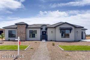 Gorgeous Ranch Style Home with 3 Car Garage (2 Car Side Entrance and 1 Stall Pass Through)