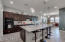 Gourmet kitchen features oversized island/breakfast bar.