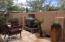 Back yard with travertine pavers.