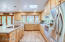 Kitchen with Stainless Steel Appliances, Hickory Cabinets and lots of natural light.