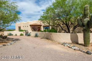 Front of home with Courtyard and Saguaro Home on 2.29 acres