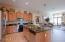 Spacious kitchen with stainless appliances.
