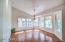Large dining room framed in windows
