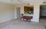 Kitchen pass thru with extra walk in closet, ceiling fan and large living room.