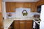 Lovely oak cabinets in this very functional U shaped kitchen
