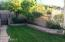 To wet your green thumb buds.... The side yard is just steps from the master exit. This area is lush with producing BlackBerry bushes, Rasberry bushes, and producing almond tree,. Masterfully framed with hybrid Bermuda and Bob sod.