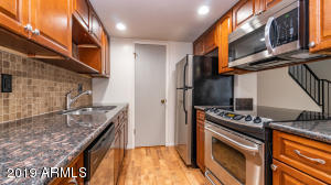Kitchen-- New cabs, granite, stainless appliances, New LED canned lighting. Door to pantry.
