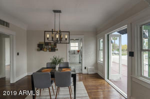 Huge original dining room with breezy patio doors for entertaining