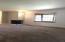 Huge living room with brick fireplace and mantel. Bay window, dual pane glass.