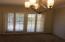 Southwestern shutters on windows & door to back yard.
