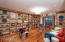 Living room featuring hardwood floors and bookcases