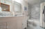 Recently remodeled Carrara Marble Title