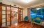 Great office space/den adjacent to front door