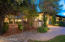 Beautiful mature landscaping leads to dining courtyard