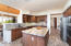 Granite counters with tile backsplash accents